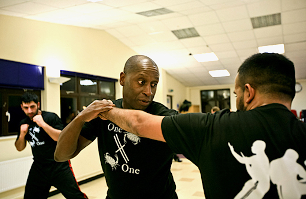 Rob shows a student kickboxing technique at the Isleworth Studio
