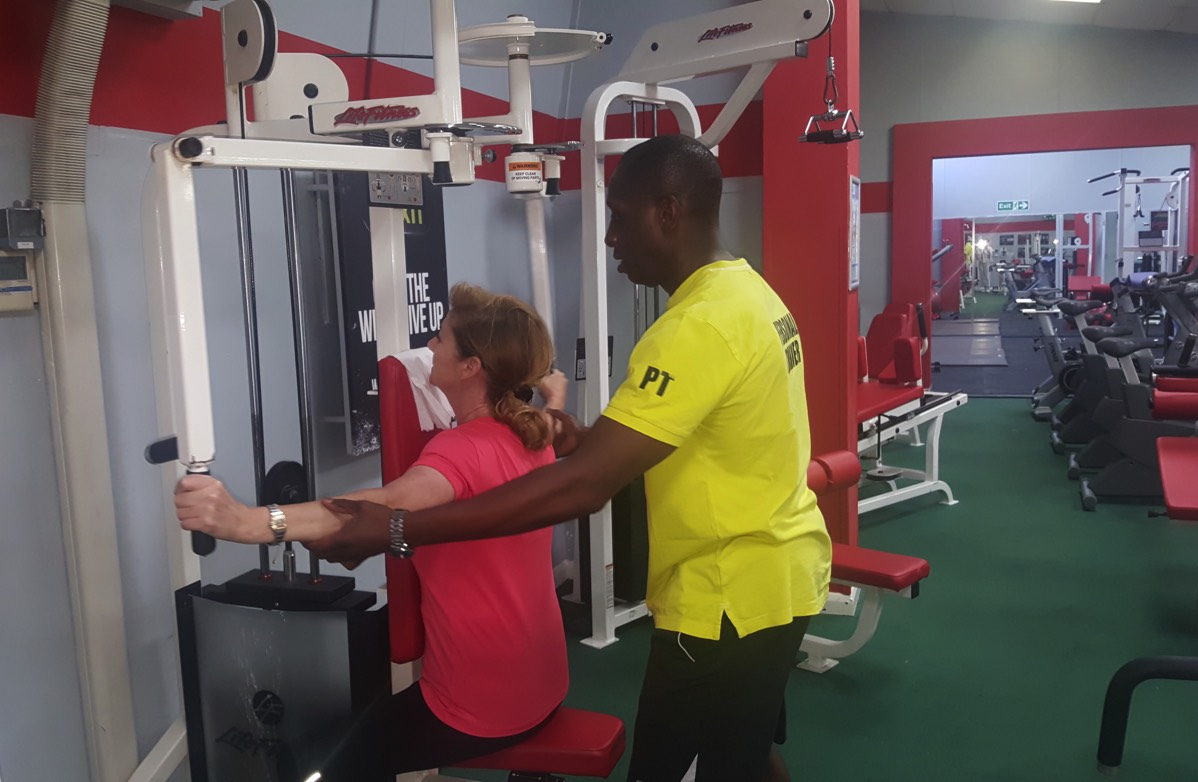 Rob takes a client through a weight traing personal training session