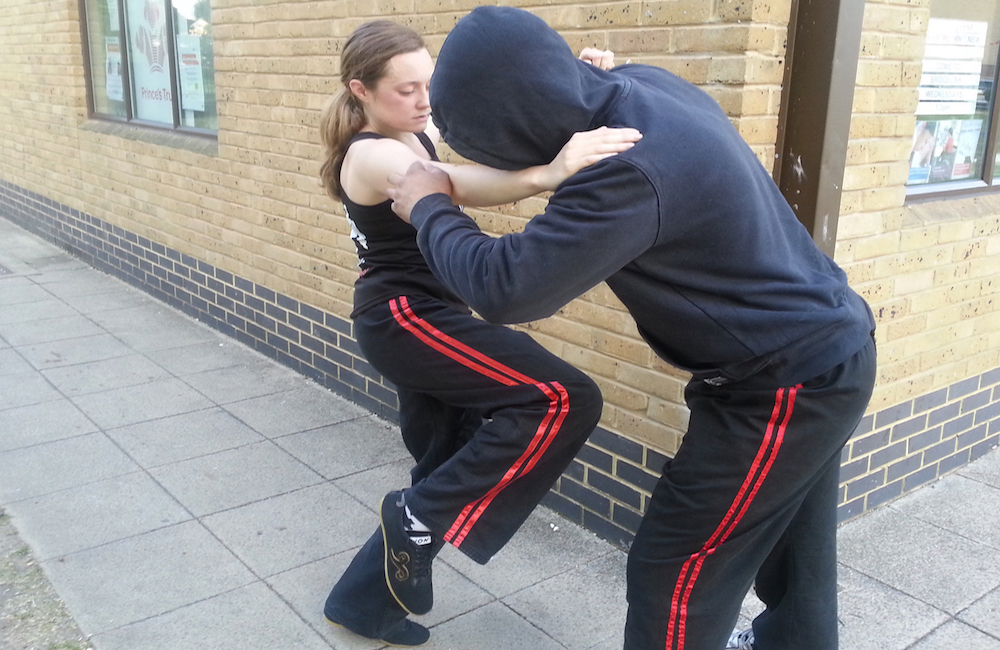 A Student performs street self defence technique on a would be assailant